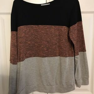 Gray pink and black long sleeve shirt
